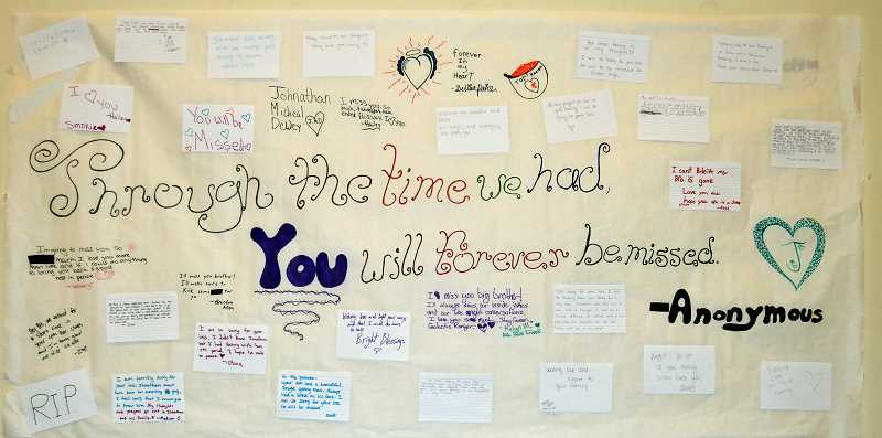 PIONEER PHOTO: CINDY FAMA - Colton High School students designed a poster where they could share thoughts and memories of Johnathan Dewey. It will be presented to his family.