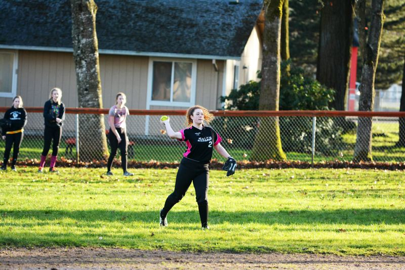 SPOTLIGHT FILE PHOTO - The Scappoose High School varsity softball team practices at its home field near the school district office between Southwest 3rd Street and Scappoose High School Way. The field needs a variety of upgrades to come into compliance with federal guidelines that require gender equality in school programs, including athletics. The varsity field does not have permanent restrooms or a concession stand, amenities that exist for the boys' baseball team.