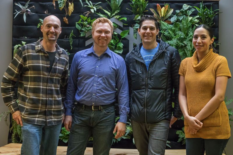 TRIBUNE PHOTO: JONATHAN HOUSE - The three cofounders of Hinge, Michael Kuehn, Roland Gauthier and Alex Tysowsky and Production Manager/Storyboard Artist  Tiffany Purkeypile, in front of the living wall at the company's studio.