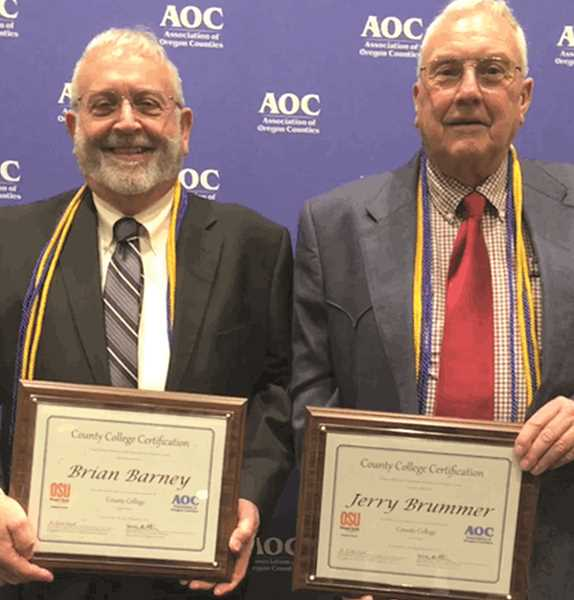 PHOTO SUBMITTED BY BRIAN BARNEY - Commissioners Brian Barney (left) and Jerry Brummer display their County College certificates upon completion of the program.