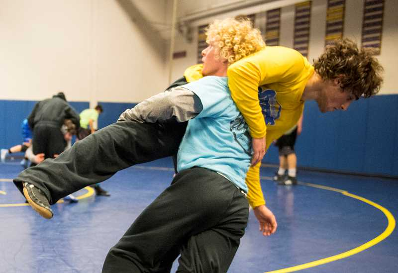 LON AUSTIN/CENTRAL OREGONIAN - Pacer Quire takes down Tyler Fioravanti during a drill at a recent practice. Both Quire and Fioravanti have state tournament experience.