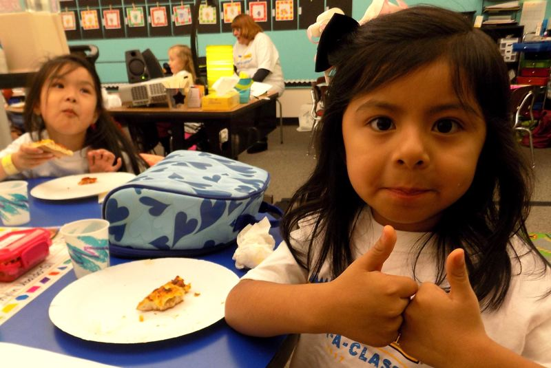 CONTRIBUTED PHOTO: HOLLYDALE ELEMENTARY SCHOOL - The pizza party earns two thumbs up.