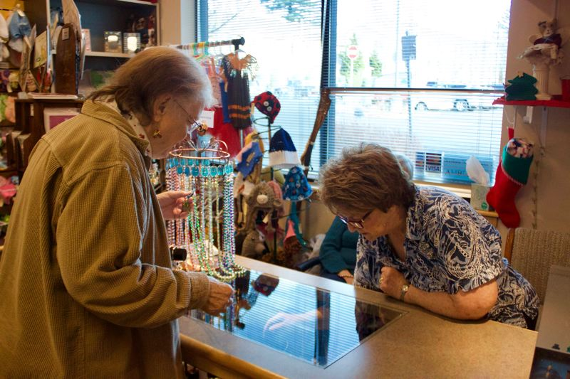 OUTLOOK PHOTO: CHRISTOPHER KEIZUR - Gresham Senior Center President Charlyn Salb looks at jewelry in the Ambleside Shoppe.