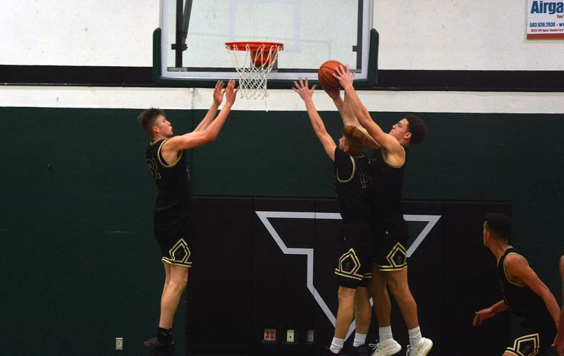 TIMES PHOTO: MATT SINGLEDECKER - Southridge senior Filip Fullerton, junior Zach Galvin and senior Bradley Bickler go up for a rebound against South Salem.