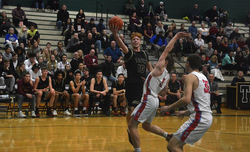TIMES PHOTO: MATT SINGLEDECKER - Southridge junior point guard Zach Galvin gets to the rim in the second half against South Salem.