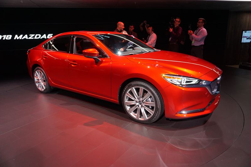 PORTLAND TRIBUNE: JEFF ZURSCHMEIDE - Mazda unveiled an updated version of their flagship Mazda6 mid-size sedan, now offered with an upgraded interior and a turbocharged 2.5-liter engine good for 250 horsepower and 310 pound-feet of torque.
