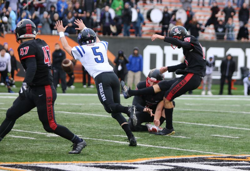 REVIEW/NEWS PHOTO: JIM BESEDA - Clackamas' Jeffrey Nelson hit a 37-yard field goal with three seconds to play, lifing the Cavaliers to a 31-30 victory over South Medford in Saturday's 6A football state final at Reser Stadium in Corvallis.