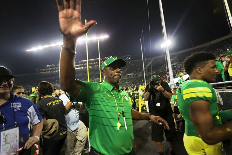 TRIBUNE FILE PHOTO: JAIME VALDEZ - Willie Taggart waves to fans after his debut as Oregon Ducks coach in a 77-21 win over Southern Utah on Sept. 2 at Autzen Stadium.