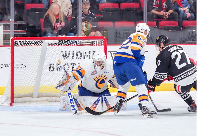 COUTRESY: CHAD BAKER/PORTLAND WINTERHAWKS - Nolan Maier of Saskatoon makes a save on Brad Ginnell of the Portland Winterhawks.