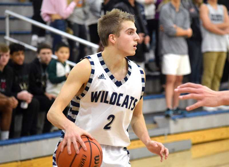 SPOKESMAN PHOTO: TANNER RUSS - Senior Caleb Larsen was a crucial part in Wilsonvilles tournament victory at home. The Wildcats won the Wilsonville Invitational Tournament to start their season 3-0.