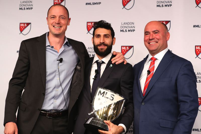 TRIBUNE PHOTO: DIEGO G. DIAZ - Portland Timbers midfielder Diego Valeri (center) celebrates his MLS MVP award with team owner Merritt Paulson (left) and Lino DiCuollo, MLS Senior Vice President, Competition & Player Relations.