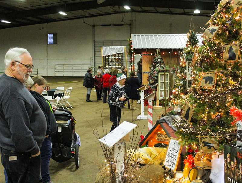 JASON CHANEY/CENTRAL OREGONIAN - Visitors admire the 'A Hunter's Best Friend' display donated by Coldwell Banker Sun Country Realty.