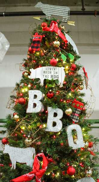 JASON CHANEY/CENTRAL OREGONIAN - Jim and Donna Roths, of Dillon's Grill, donated the 'Rib Racks Roasting on an Open Fire' tree. The barbecue-inspired Christmas tree featured a smoker and assortment of barbecue wood chips.