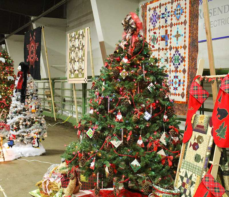 JASON CHANEY/CENTRAL OREGONIAN - Crook County Morning Quilt Guild donated 'A Log Cabin Christmas,' featuring a tree decorated with hand-crafted pine cone and log cabin ornaments as well as a quilted log cabin tree skirt, stockings, an outdoor-themed quilt and other handmade gifts.