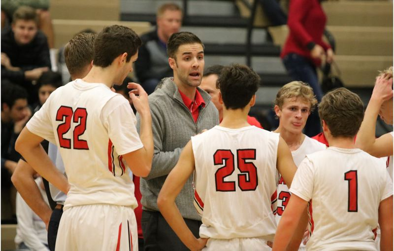 REVIEW/NEWS PHOTO: JIM BESEDA - Clackamas coach Cameron Mitchell talks strategy during a timeout in Friday's boys' basketball season opener against Jesuit.