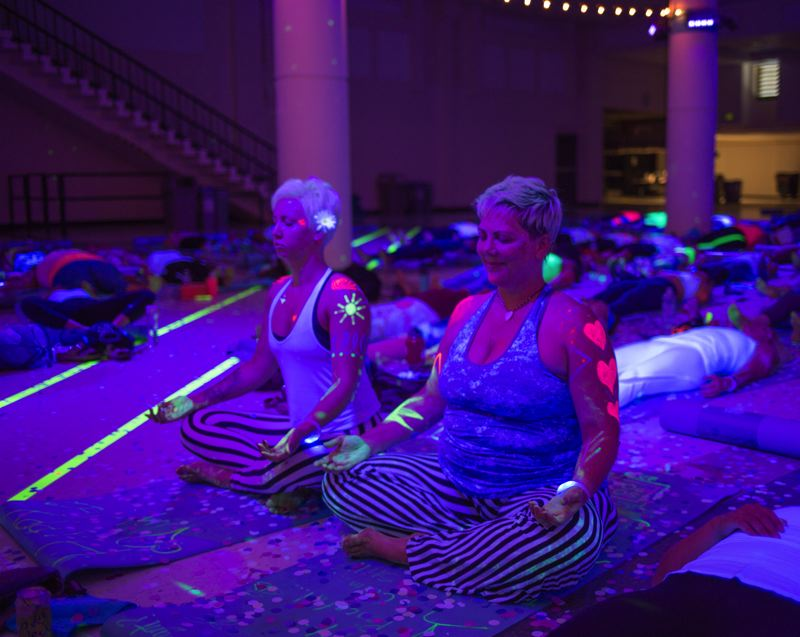 COURTESY: SOUL POSE - Soul Pose, Dec. 9 at Expo Center, is blacklight yoga with a pre-event block party, vendors, body paint, confetti, dancing and music. Part of a national series, Soul Pose is slated to return to Portland in 2018, organizers say.