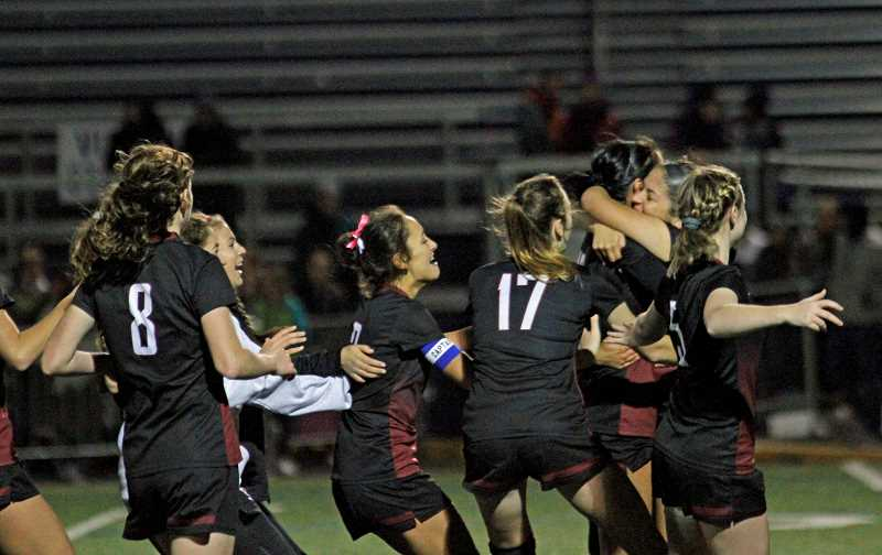 HILLSBORO TRIBUNE PHOTO: WADE EVANSON - The Glencoe girls soccer team celebrates following their penalty kick win over South Eugene in the state quarterfinals.