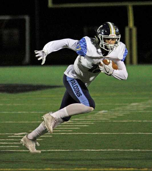 HILLSBORO TRIBUNE PHOTO: WADE EVANSON - Liberty's Aidan Maloney carries the ball during a game against Southridge. Maloney was a first-team offensive and second-team defensive All-Metro selection this season.