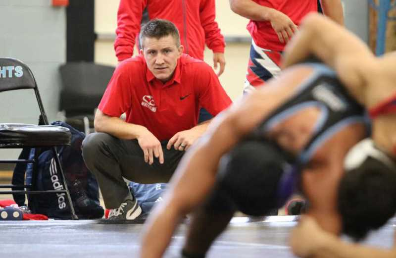 PHOTO COURTESY OF JIM BESADA/CLACKAMAS REVIEW  - Clackamas Community College coach Josh Rhoden has compiled a 122-31-2 dual meet record in 12 seasons with the Cougars, including a 4-0 start to open the 2017-18 season.