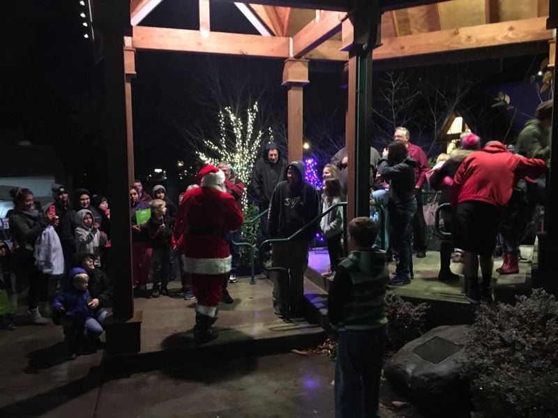 CONTRIBUTED: GREG DIRKS - Santa approaches Wood Village City Hall on Saturday, Dec. 2 during the city's annual tree lighting event. In a speech, Mayor Tim Clark concluded by saying, 'I personally want to thank you for coming. This time of year can be stressful. I hope when you leave tonight, you will have a little bit more jingle in your step and Christmas joy in your heart.'