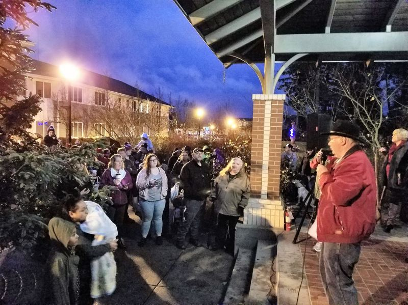 CONTRIBUTED PHOTO: BRIAN COOPER - Mayor Ted Tosterud addresses the crowd during a Christmas tree lighting ceremony on Saturday, Dec. 2.