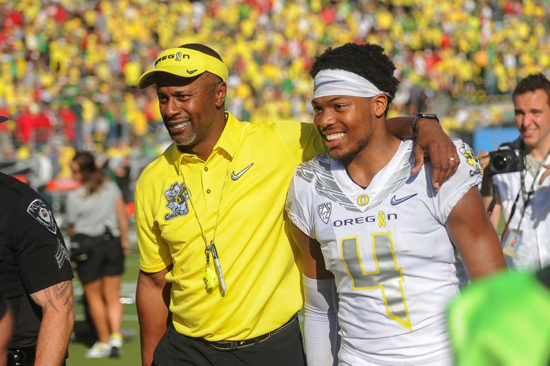 TRIBUNE FILE PHOTO: JAIME VALDEZ - Willie Taggart (left) leaves the field at Autzen Stadium with Oregon defensive back Thomas Graham Jr., after the Ducks' victory this season over Nebraska.