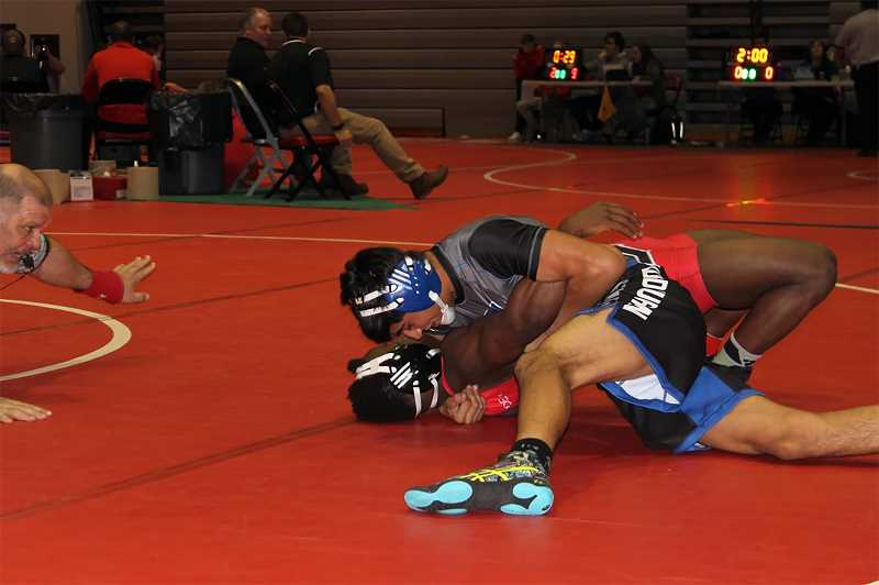 COURTESY PHOTO - Woodburn junior Giovanni Bravo won the 145-pound bracket at the Tyrone S. Woods Memorial Tournament by pinning his first three opponents and scoring major decisions in the semifinal and final matches.