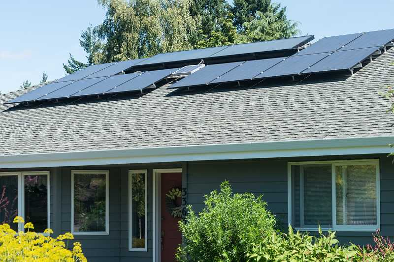 NEWS-TIMES PHOTO: CHRISTOPHER OERTELL - This home is one of 14 buildings in Forest Grove that have used the city's incentive program for solar panels.
