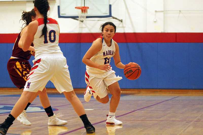 WILL DENNER/MADRAS PIONEER - Chloe Smith (11) was one of several Buffs who provided instant offense from the bench during last weekend's homes games.