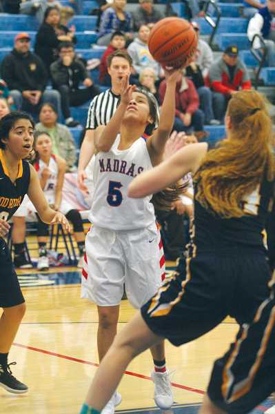 WILL DENNER/MADRAS PIONEER - Vanessa Culps (5) was deadly from long range at last weekend's Madras Invitational, hitting seven 3-pointers combined in two games.