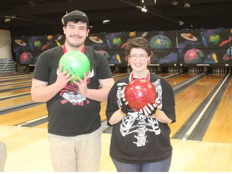 SUSAN MATHENY/MADRAS PIONEER - Micah Webb and Jessica Peles won gold medals in the regional Special Olympics Bowling Tournament. Webb will go on to the national contest.