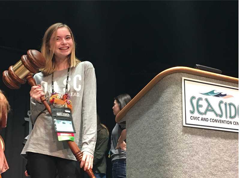 COURTESY: HAILEY HARDCASTLE - Hailey Hardcastle receives the ceremonial gavel after winning the campaign for state student president at OASC's Seaside conference.
