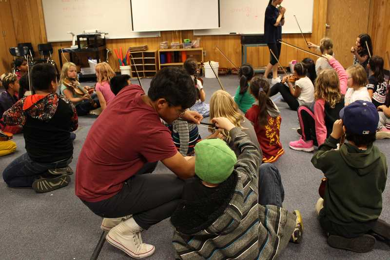 COURTESY: PROJECT PRELUDE - Project Prelude brings high school volunteers to three Title I Beaverton elementary schools, where they teach violin and flute.