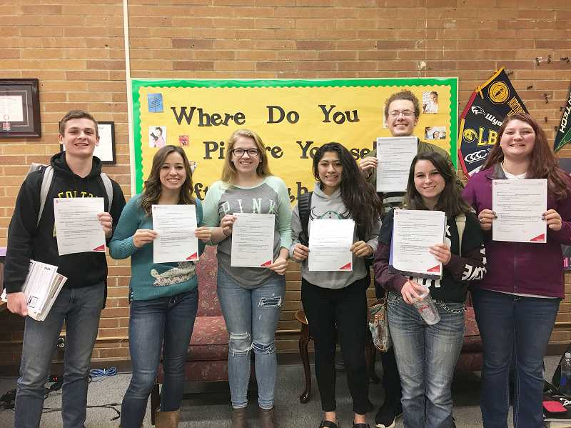 PIONEER PHOTO: CINDY FAMA - Instant admission to Western Oregon University was awarded to CHS seniors from left to right: Dawson Hall, Brooklyn Olsen, Maria Winczewski, Katie Wills, Austin Carlisle, Rayne Burke and Elaine Zinsli.