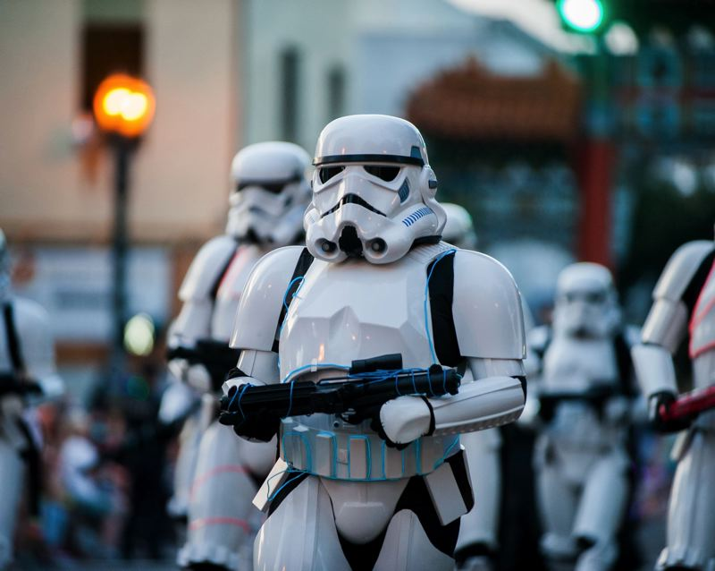 FILE - Costumed Imperial stormtroopers march in the Starlight Parade in downtown Portland in 2016.