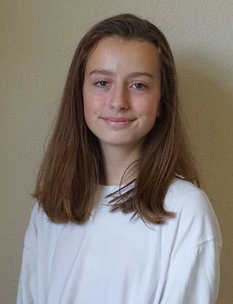 REVIEW PHOTO: CLAIRE HOLLEY - Lake Oswego Junior High eighth-grader Leila Hardy is already a published author and is now at work on her second book. 'The first book is for people who have a will to learn but no resources,' she says. 'The other book is for people who have an abundance of resources but no time or motivation to learn about the issue.'