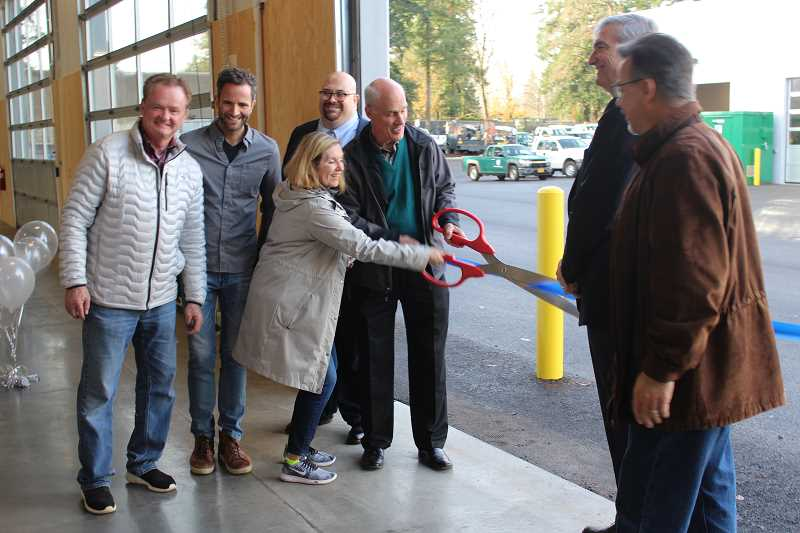 REVIEW PHOTO: ANTHONY MACUK - City officials cut the ribbon to officially open Lake Oswego's new Operations and Maintenance Center last week. From left: City Councilors Skip ONeill, Joe Buck and Jackie Manz; Public Works Director Anthony Hooper; Mayor Kent Studebaker; and City Councilors Jeff Gudman and John LaMotte.