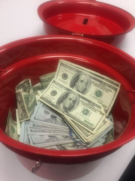 COURTESY PHOTO: THE SALVATION ARMY - Someone dropped $10,000 in $100 bills in a Salvation Army Red Kettle outside the Fred Meyer store on Northeast Weidler Street sometime Wednesday, Dec. 6.