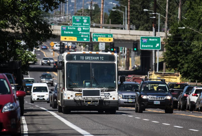 TRIBUNE PHOTO: JONATHAN HOUSE - The #44 and other routes that use Southeast Division may one day have longer, articualted TriMet buses with stops that stick out into traffic instead of being cut in.