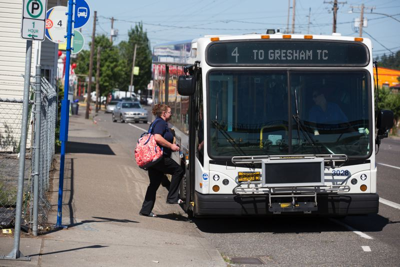 TRIBUNE PHOTO: JONATHAN HOUSE - The #4 bus to Gresham stops to pick up a passenger near SE 92nd Ave.