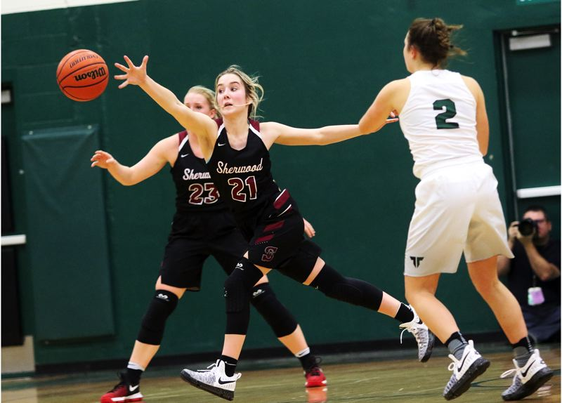 DAN BROOD - The Sherwood High School girls basketball team will likely rely on senior Lauren Scarvie (21) to do a lot of things for the squad this year. Scarvie, a three-year starter, is one of the team's three captains.
