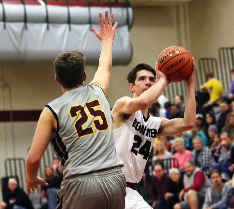 DAN BROOD - Sherwood senior Jordan Gregory (right) looks to shoot over Forest Grove's Adison Emerick.