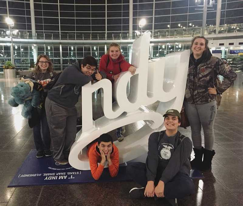 SUBMITTED PHOTO: MACKENZIE BEHRLE - Molalla FFA students stop for a photo before flying home from the National Convention Oct. 23-29.
