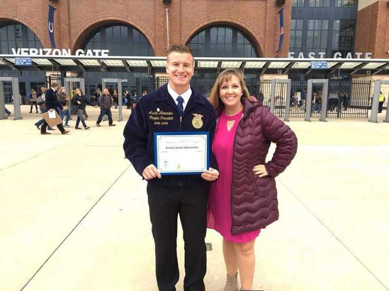 SUBMITTED PHOTO: MACKENZIE BEHRLE - Austin Alexander and adviser Mackenzie Behrle pose after Alexander received his American FFA degree at the National Convention Oct. 23-29.