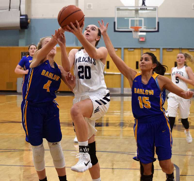SPOKESMAN PHOTO: TANNER RUSS - Junior Emily Scanlan goes in for a lay up against the visiting Barlow Bruins. Wilsonville defeated Barlow 82-28 on Dec. 8.