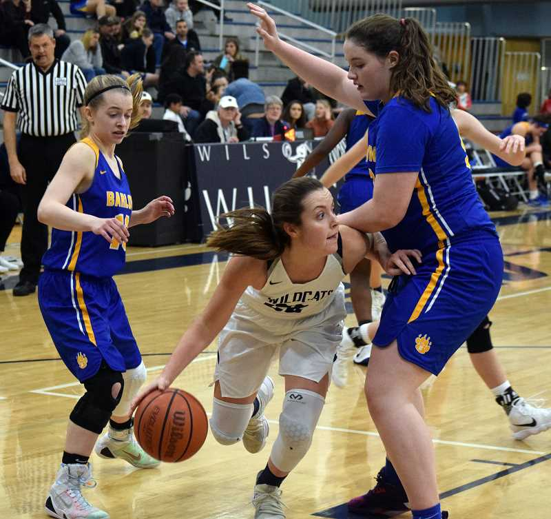 SPOKESMAN PHOTO: TANNER RUSS - Junior Cydney Gutridge moves around a defender, searching for an open teammate. Wilsonville defeated the visiting Barlow Bruins 82-28 on Friday, Dec. 8.