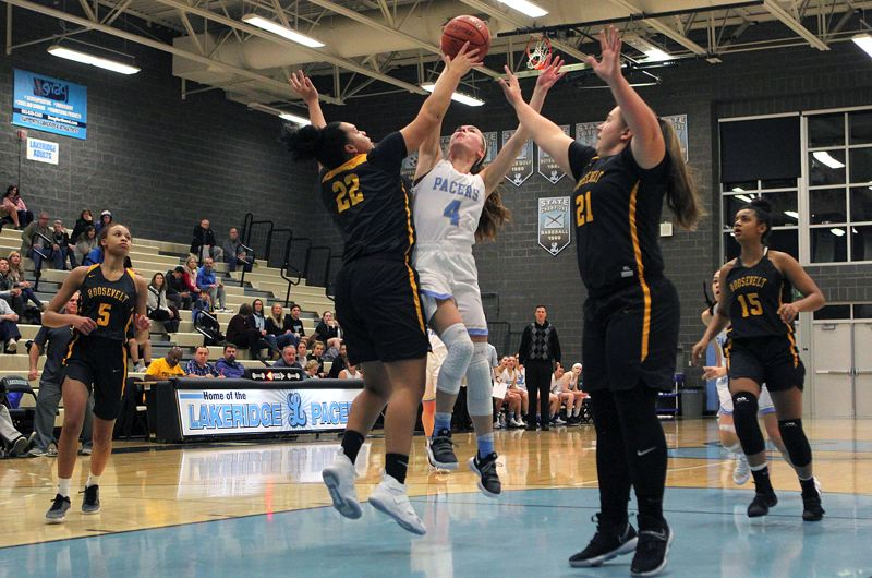 REVIEW PHOTO: MILES VANCE - Lakeridge senior guard Laura Barton goes to the basket early in her team's 71-51 non-league home win over Roosevelt on Friday at Lakeridge High School.