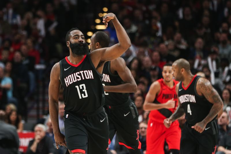 TRIBUNE PHOTO: DAVID BLAIR - Houston's James Harden gestures to the crowd at Moda Center after making a 3-pointer against Portland.