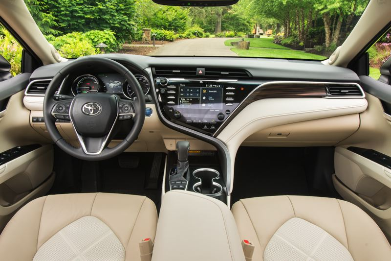 TOYOTA MOTOR NORTH AMERICA - The interior of the 2018 Toyota Camry Hybrid is roomy, comfortable and can be outfitted with leather and advanced safety features.