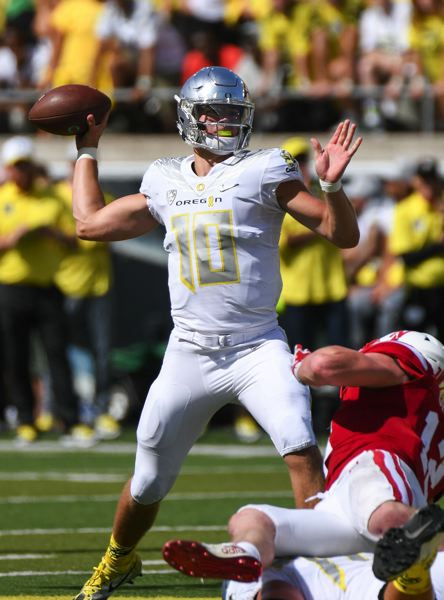 TRIBUNE FILE PHOTO: JOSH KULLA - The Oregon Ducks are 5-1 this season with Justin Herbert starting and finishing at quarterback. He missed about a third of the season with a broken collarbone but will start Dec. 16 in the Las Vegas Bowl against Boise State.